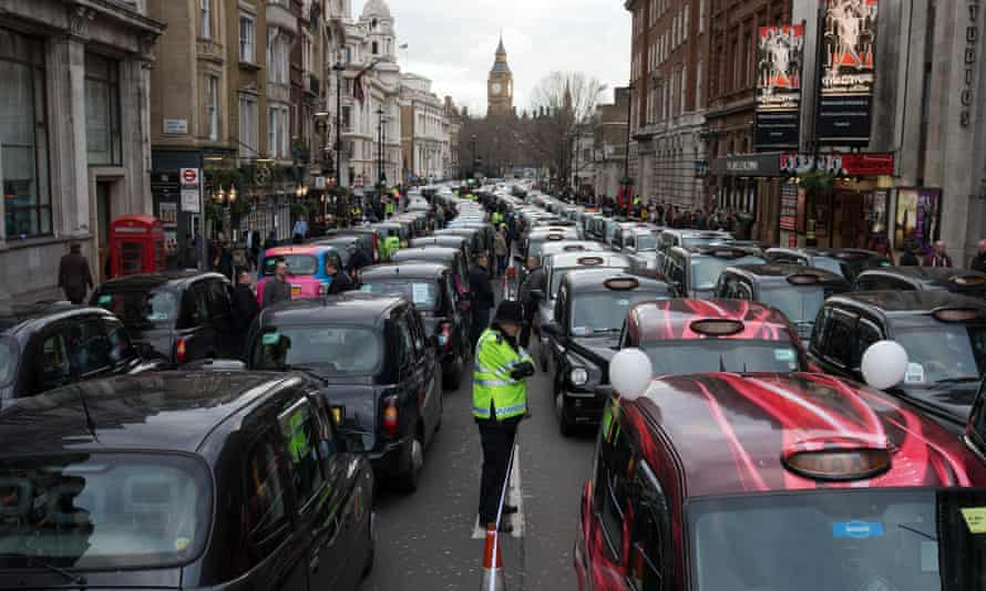 London black cab drivers block Whitehall as they take part in a protest against Uber on 10 February, 2016.