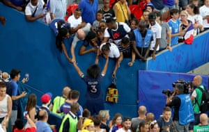 Wendie Renard of France with fans following their Quarter Final defeat to USA at Parc des Princes.