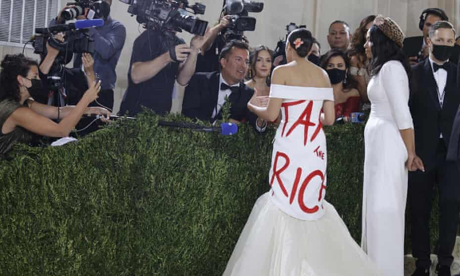Alexandria Ocasio-Cortez and Aurora James in her Tax the Rich dress.
