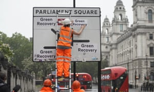 Greenpeace activists replace the destinations on the road signs around Westminster to read 'Green Recovery'.