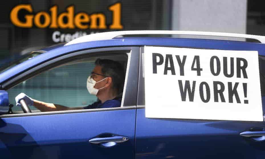 Uber and Lyft drivers held a protest in Los Angeles after being denied unemployment insurance during the pandemic, April 2020.