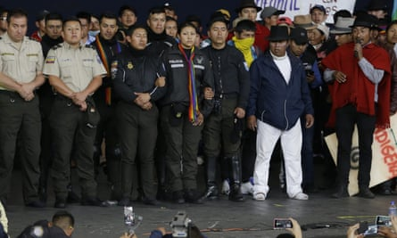 Police officers detained by anti-government protesters are presented on a stage at the Casa de Cultura in Quito, Ecuador, on Thursday.