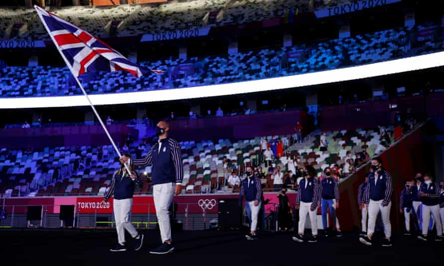 Flag-bearers Hannah Mills and Mohamed Sbihi of Great Britain lead the team out at the opening ceremony of the Tokyo 2020 Olympic Games.