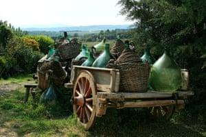 Large jugs (carboy, demijohn) on a wagon, Chianti Region, Tuscany, Italy