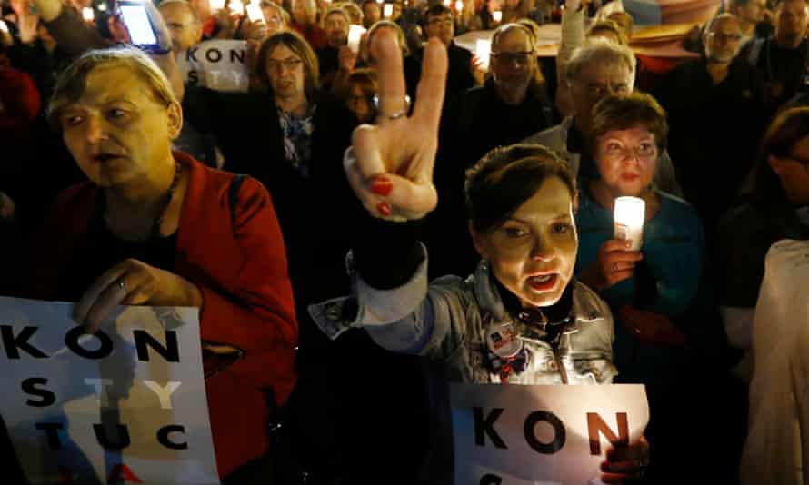 People protest against the reforms outside the supreme court in Warsaw on Tuesday.