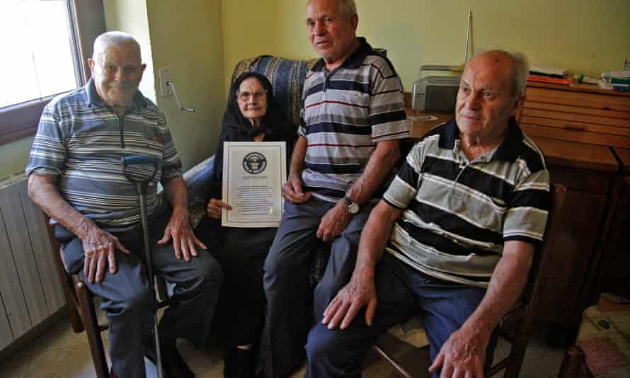 Consolata Melis with her three brothers in her house in Perdasdefogu in 2012, just before her 105th birthday.