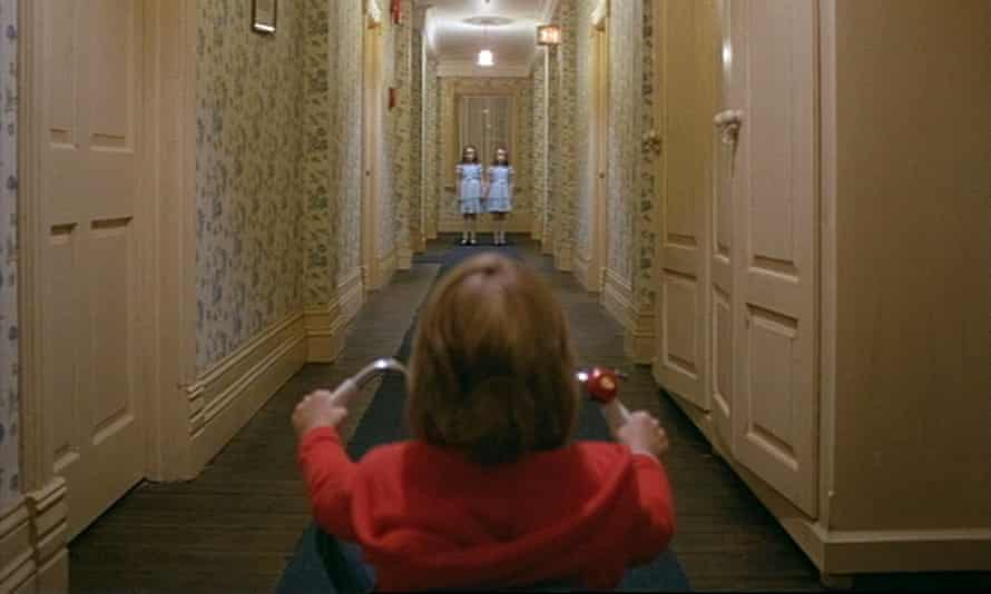 Lloyd on his trike in The Shining, riding toward Lisa and Louise Burns, the Grady twins.