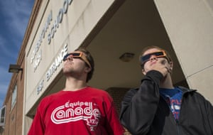 Boyertown high school students wear safety glasses as they look for Mercury, in Pennsylvania, US