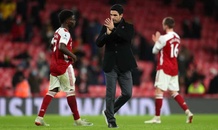 Mikel Arteta applauds Arsenal's fans after the home defeat by Burnley.