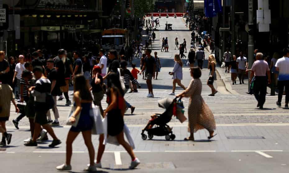 pedestrians crossing a Sydney city street