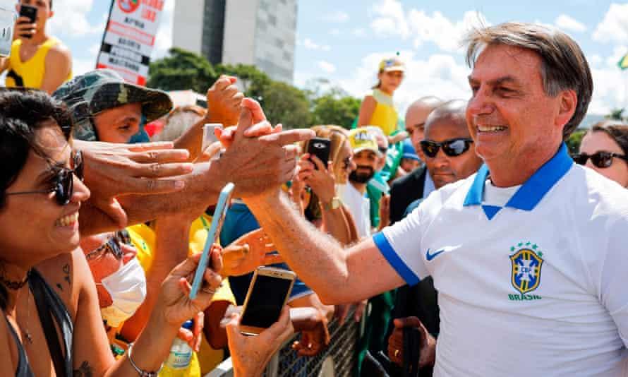 Jair Bolsonaro greets supporters in Brasilia.