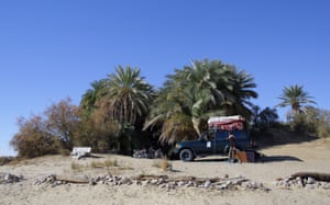 A desert safari vehicle next to Ain Khadra oasis