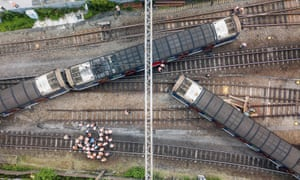 Rescue workers stand near a passenger train after it derailed during rush hour outside Hung Hom station on the Kowloon side of Hong Kong.