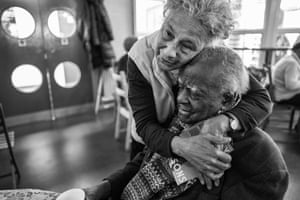 Daphne greets Levi at one of the regular Monday meetings of Stockwell Good Neighbours, from Windrush generation portraits by Jim Grover
