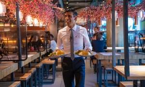 Rishi Sunak visits a Wagamama restaurant in central London.