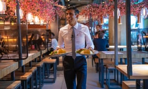 Rishi Sunak serving food at a Wagamama restaurant in London. The chancellor has promised a 'fundamental review' of business rates to support the high street.