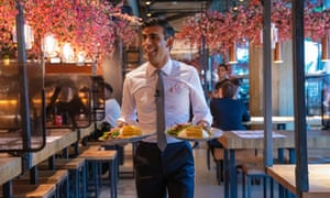 Chancellor Rishi Sunak serving diners at a branch of Wagamama restaurant