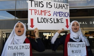 Noor Hindi (left) and Sham Najjar who were born in the US of Syrian parents, demonstrate against the immigration ban imposed by President Trump at the Los Angeles International Airport
