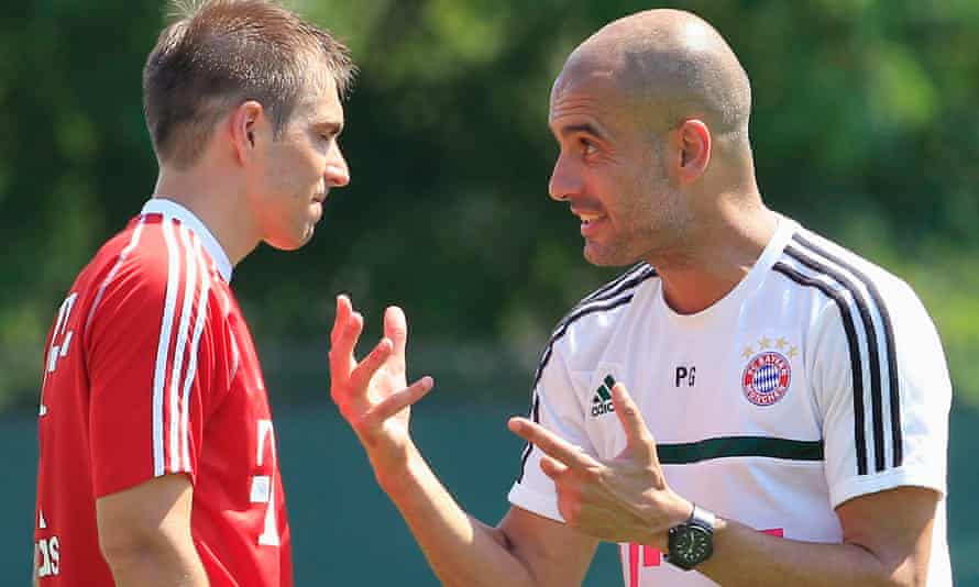 Philipp Lahm receives instructions from the then Bayern Munich head coach Pep Guardiola in 2013