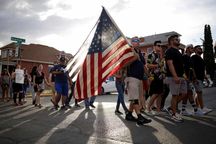 People take part in a rally against hate a day after a mass shooting at a Walmart store, in El Paso, Texas.