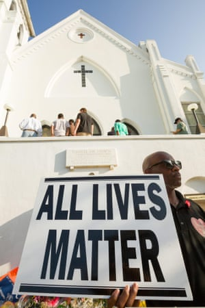 A demonstrator holds a sign outside Emanuel AME church
