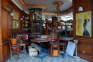 Chairs and tables are seen piled up in a closed restaurant in Paris amid in France, on 27 April, 2021.