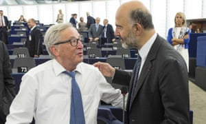 Jean-Claude Juncker, left, talks to Pierre Moscovici before delivering his state of the union address at the European parliament.