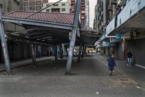 Residents walk in deserted streets of Johannesburg during the coronavirus lockdown.