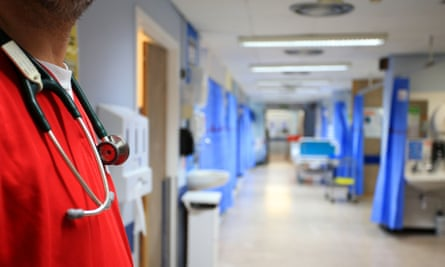 A doctor in a hospital ward