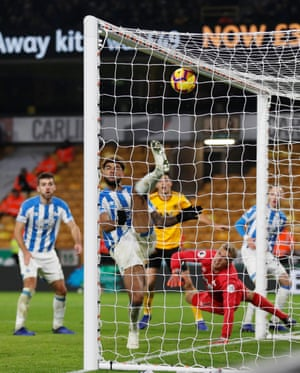 Top billing: Huddersfield Town's Philip Billing clears the ball off the line in acrobatic fashion against Wolves