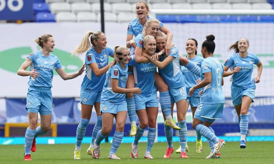 Manchester City players mob Steph Houghton after her superb second-half free kick at Goodison Park.