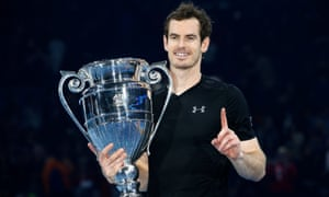 Andy Murray holds the ATP Tour Finals' trophy after his victory over Novak Djokovic confirmed he would end the year as the world No1.