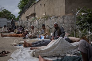 Surrounded by barbed wire, rubbish and the smell of urine, hundreds of Afghans sleep on the floor for days, waiting for their turn to apply for a visa to Pakistan.