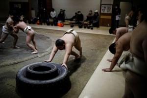 Kumagai pushes tires while training