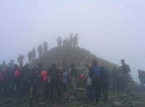 """<strong>Queueing to summit mount Snowdon</strong><br>""""Arrived on the summit of Snowdon to bad weather and crowds. A classic British holiday experience.""""<br><br>Note in particular the guy using a selfie stick.<br><br>Photograph: <a href=""""https://witness.theguardian.com/assignment/55b6038de4b0a4260de253c7/1638113"""">Salapanda/GuardianWitness</a>"""