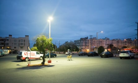Uber drivers sleep in their cars in a San Francisco parking lot.