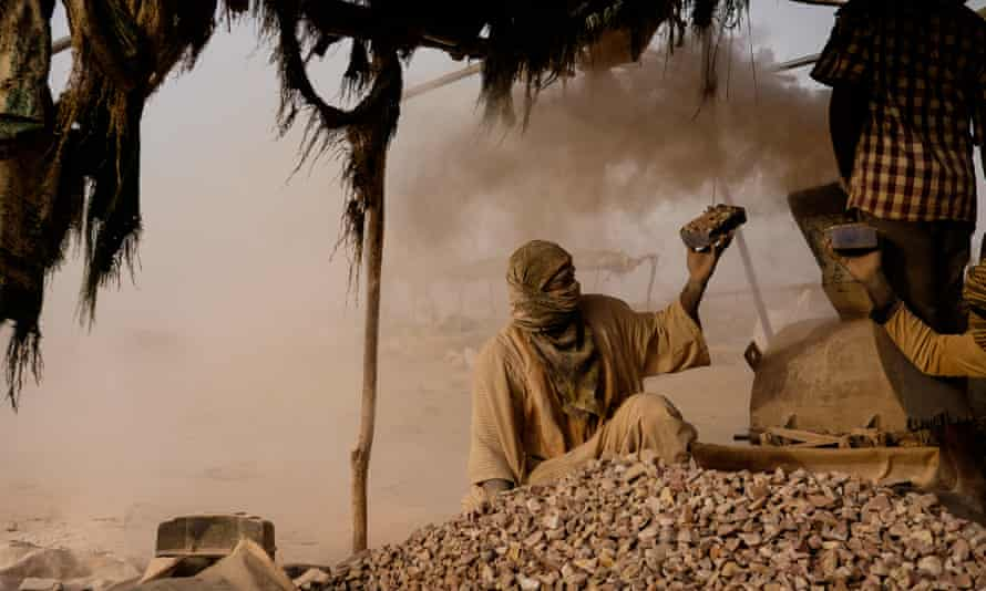 A worker at an informal mining area on northern Sudan.
