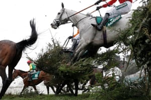 Mystifiable ridden by Paddy Brennan jumps the Canal Turn fence in the Topham Chase