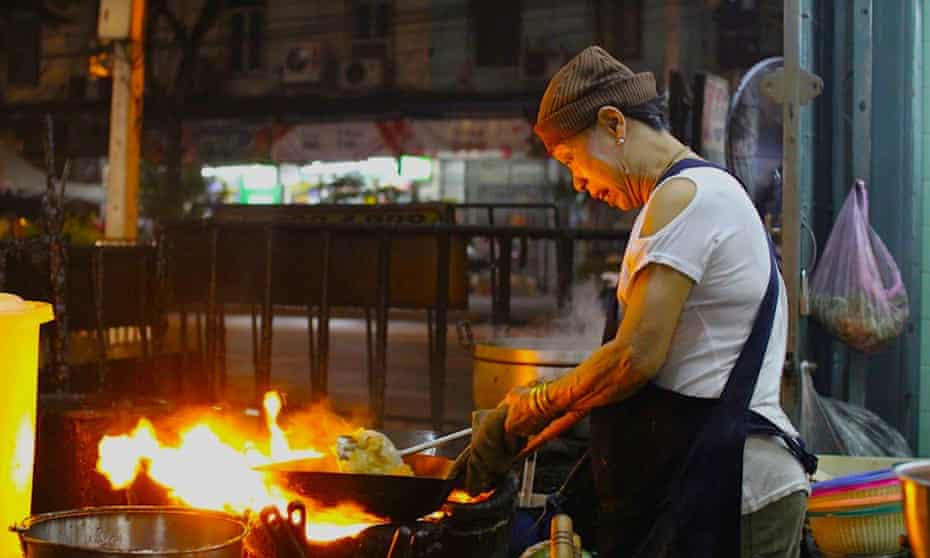 Flame on … owner and chef Jay Fai at her shop-house restaurant, Bangkok, Thailand