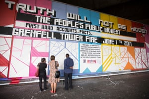 Grenfell: people look at tributes to the dead