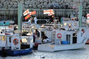 Sipekne'katik boats gather at a wharf