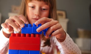 A girl playing with building blocks