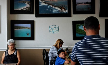 Pictures of Puerto Rico hang on the walls of Melao Bakery in Kissimmee, Florida, in August.