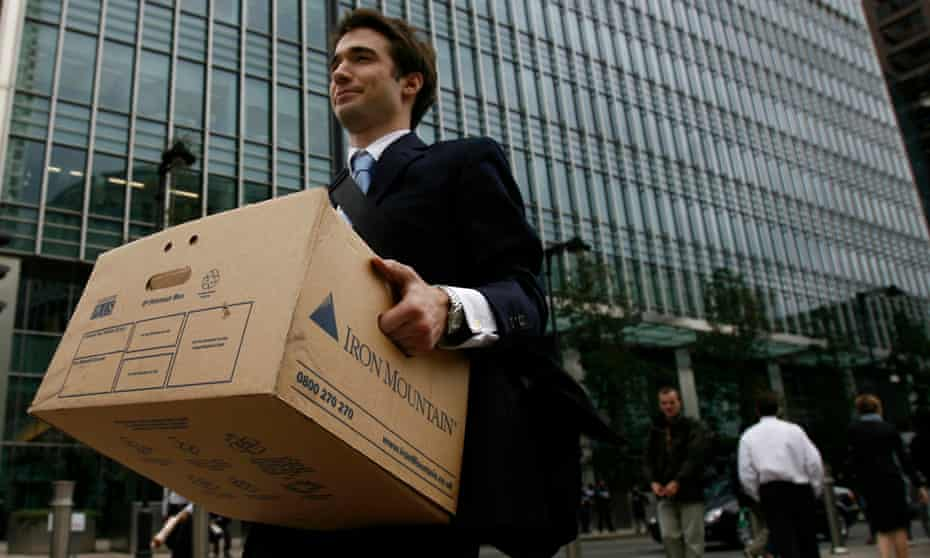 A worker carries a box out of the US investment bank Lehman Brothers in London on 15 September 2008 as it filed for bankruptcy
