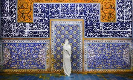 a veiled woman at the Sheikh Lotfollah Mosque, Isfahan.