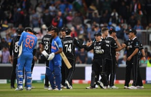 The two sides shake hands as New Zealand win the semi-final.