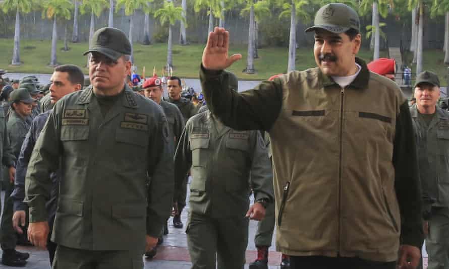 Vladimir Padrino López (left) and Nicolás Maduro