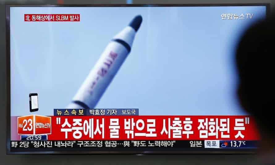 A TV news programme showing a file footage of a missile launch conducted by North Korea, Saturday, 23 April.