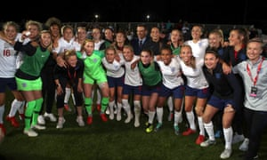 With the England squad as the team celebrate qualifying for the World Cup.