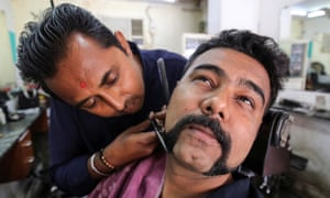 Dhiren Makvana gets his moustache trimmed in a style similar to the one sported by the Indian Air Force pilot Abhinandan Varthaman.